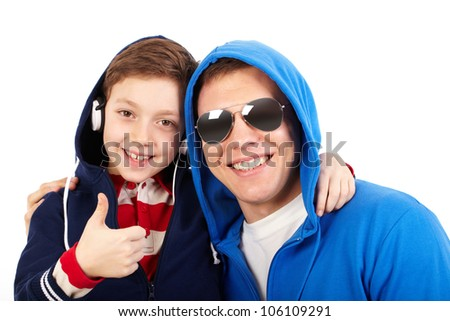 Portrait of a cool boy hanging out with his dad being no less cooler - stock photo