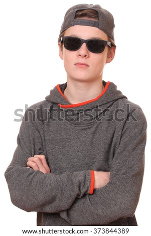 Portrait of a cool teenage boy wearing sunglasses on white background