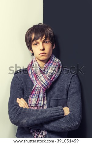 Portrait of a cool young guy standing  in casual clothes