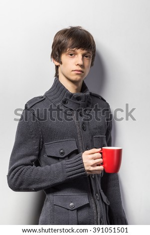 Portrait of a cool young guy standing  in casual clothes - stock photo