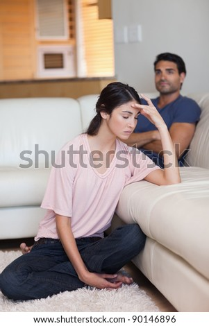 Portrait of a couple after an argument in their living room - stock photo