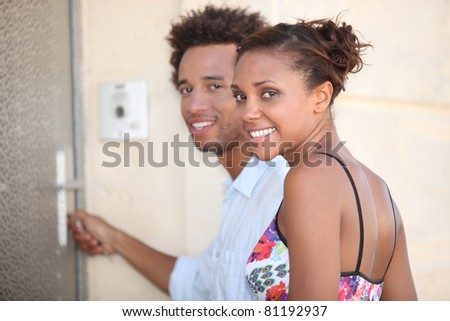 portrait of a couple at door - stock photo