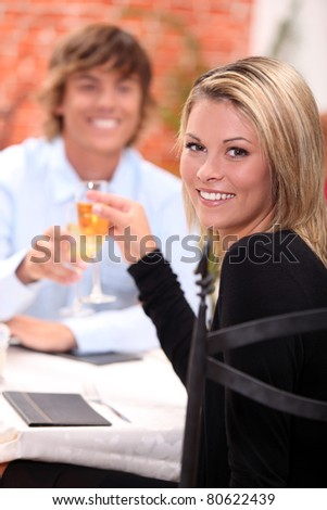 portrait of a couple at restaurant - stock photo