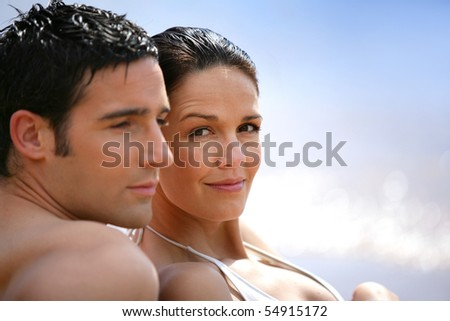 Portrait of a couple at the seaside - stock photo
