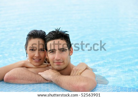Portrait of a couple in a swimming pool