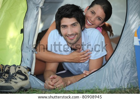 portrait of a couple in a tent - stock photo