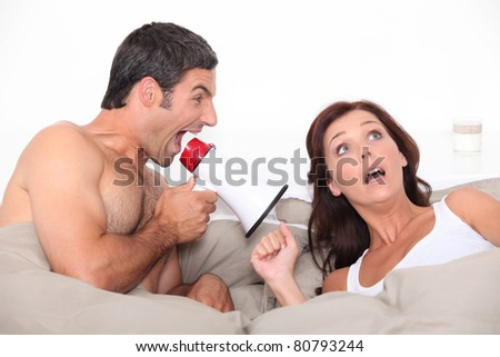 portrait of a couple in bed - stock photo