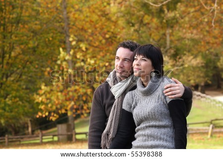 Portrait of a couple in the countryside - stock photo