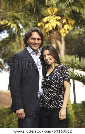 Portrait of a couple in the garden - stock photo