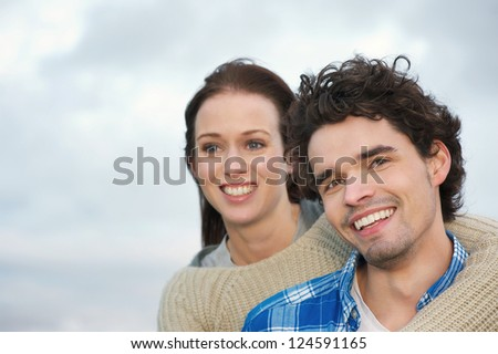 Portrait of a couple of friends smiling outdoors - stock photo