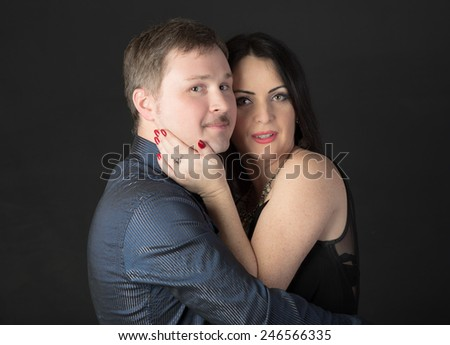 portrait of a couple on a black background - stock photo