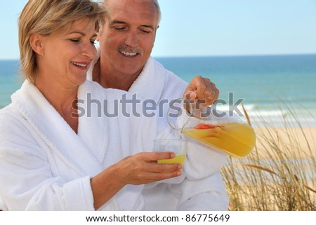 portrait of a couple on the beach - stock photo