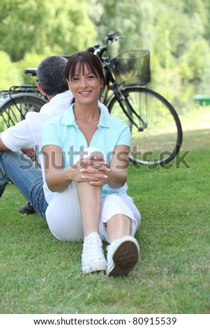 portrait of a couple on the grass - stock photo