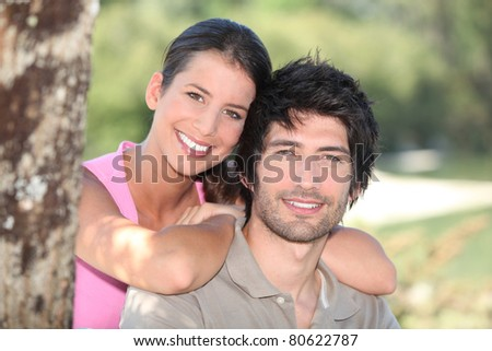 portrait of a couple outdoors - stock photo