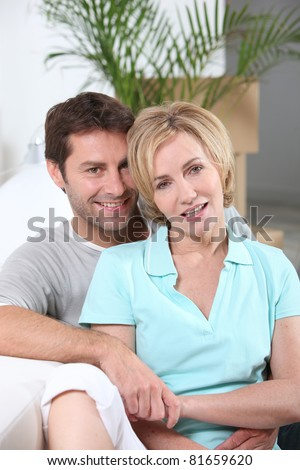 portrait of a couple with boxes - stock photo