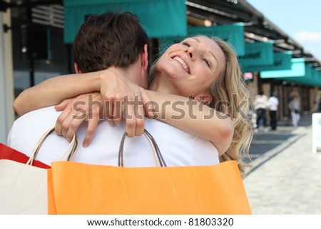 Portrait of a couple with shopping bags