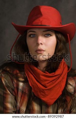 Portrait of a cowgirl in a hat. Western movie style - stock photo
