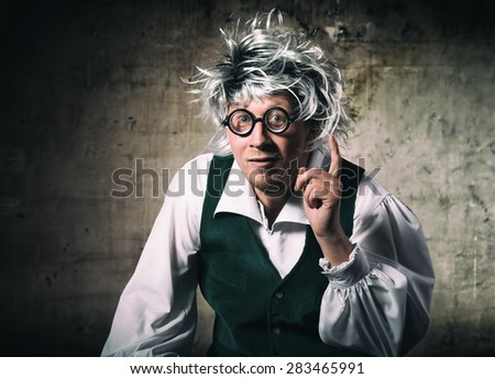 Portrait of a crazy scientist raising the index finger up  - stock photo