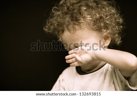 portrait of a crying child - stock photo