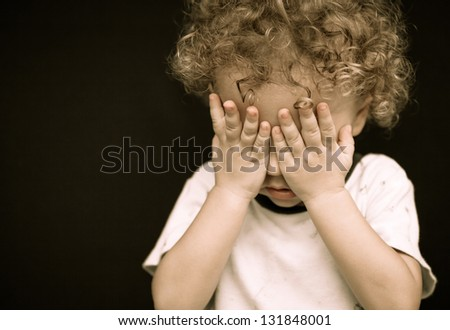 portrait of a crying little boy - stock photo