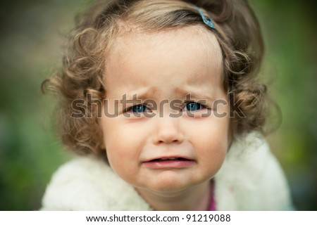 portrait of a crying little girl