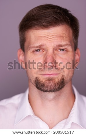 Portrait of a crying man - stock photo