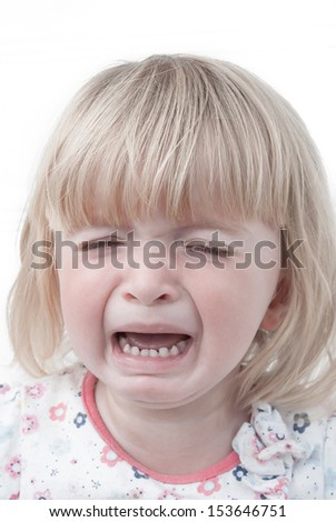 Portrait of a crying toddler.  - stock photo