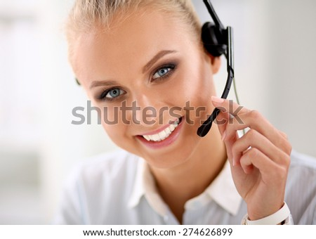 portrait of a customer service agent sitting at office. - stock photo