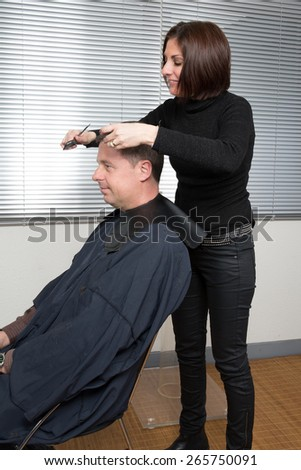 Portrait of a customer with a female hairdresser in a salon - stock photo