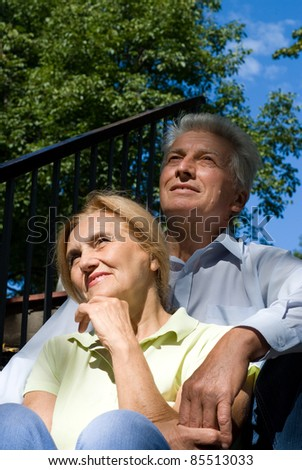 portrait of a cute aged couple outdoors