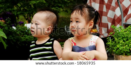 Portrait of a cute Asian boy and girl. - stock photo