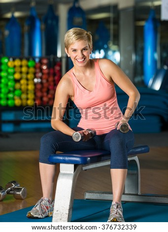 Portrait of a cute attractive female smiling after workout class in gym aerobic cardio - stock photo