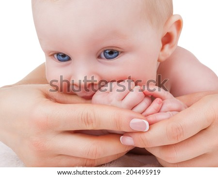 Portrait of a cute baby biting hand of mother on a white background - stock photo