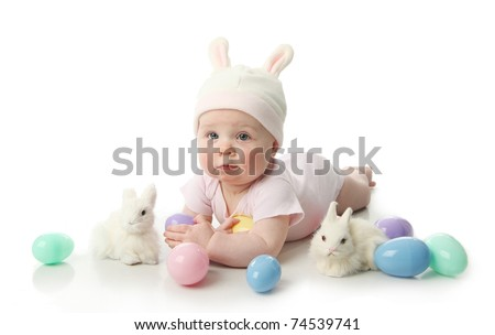 Portrait of a cute baby dressed in Easter bunny ears with pastel eggs - stock photo