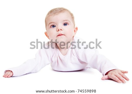 Portrait of a cute baby girl layong on her stomach