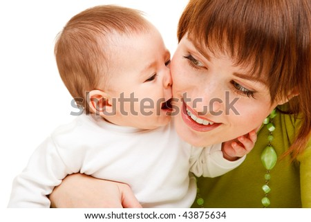 Portrait of a cute baby kissing mother - stock photo