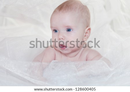 Portrait of a cute baby lies on a blanket - stock photo