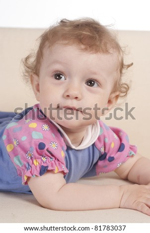portrait of a cute baby on sofa