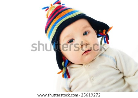portrait of a cute baby wearing a colorful warm winter hat - stock photo