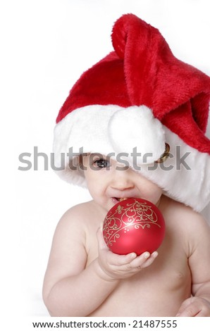 portrait of a cute baby with bauble