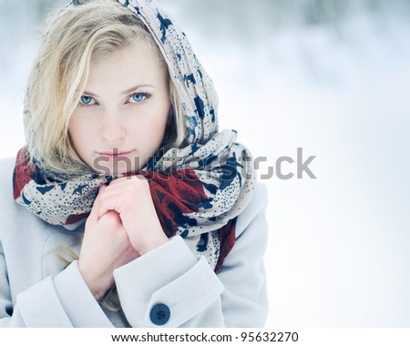 Portrait of a cute blonde in the winter - stock photo