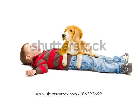Portrait of a cute boy and a dog lying on it - stock photo