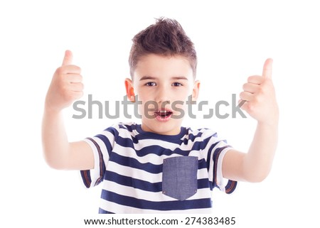 Portrait of a cute boy giving thumbs up gesture with satisfied expression - stock photo