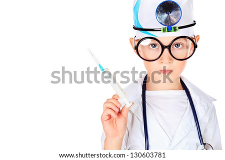 Portrait of a cute boy in big spectacles playing doctor with syringe and a stethoscope. Isolated over white. - stock photo
