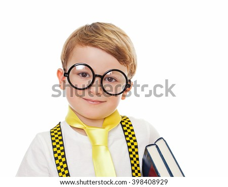 Portrait of a cute boy in nerd glasses with books