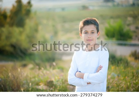 Portrait of a cute boy on the background of nature - stock photo