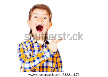Portrait of a cute boy pointing the finger in the direction and screaming. Healthcare. Education. Isolated over white. - stock photo
