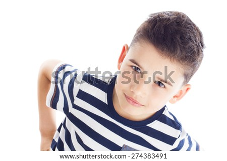 Portrait of a cute boy with hands on hips, top view - stock photo