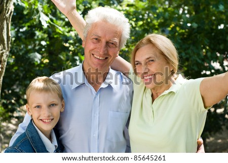 portrait of a cute boy with his grandparents
