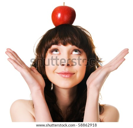 Portrait of a cute brunette with an apple on her head, white background - stock photo